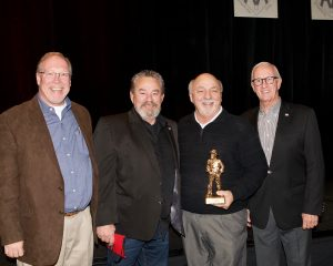Ted Powell accepts the Miner of the Year Award with colleagues from Rogers Group, Inc.