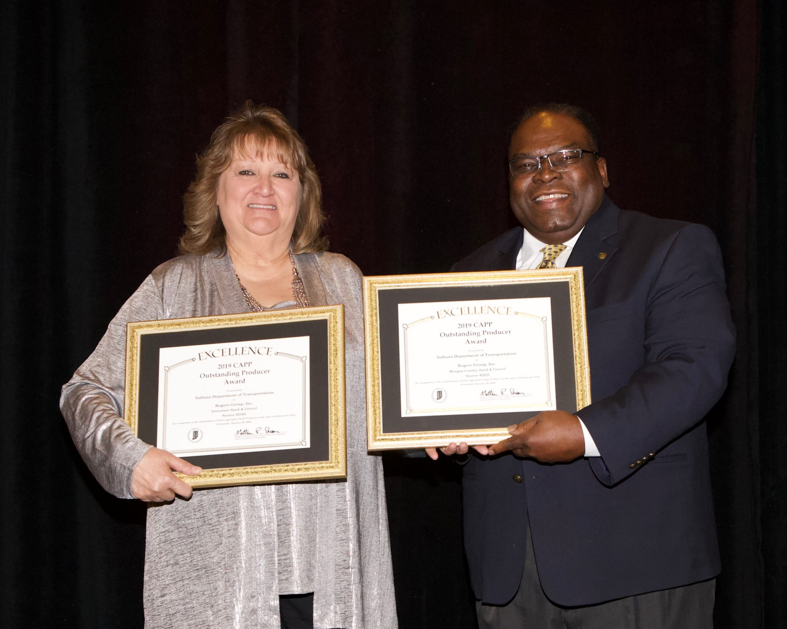 Toni Gunderman accepts the Overall State CAPP District Awards for Rogers Group, Inc. Interstate Sand & Gravel and Rogers Group, Inc. Morgan County Sand & Gravel