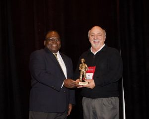 Ted Powell accepting IMAA Miner of the Year Award from IMAA Executive Director Calvin Lee